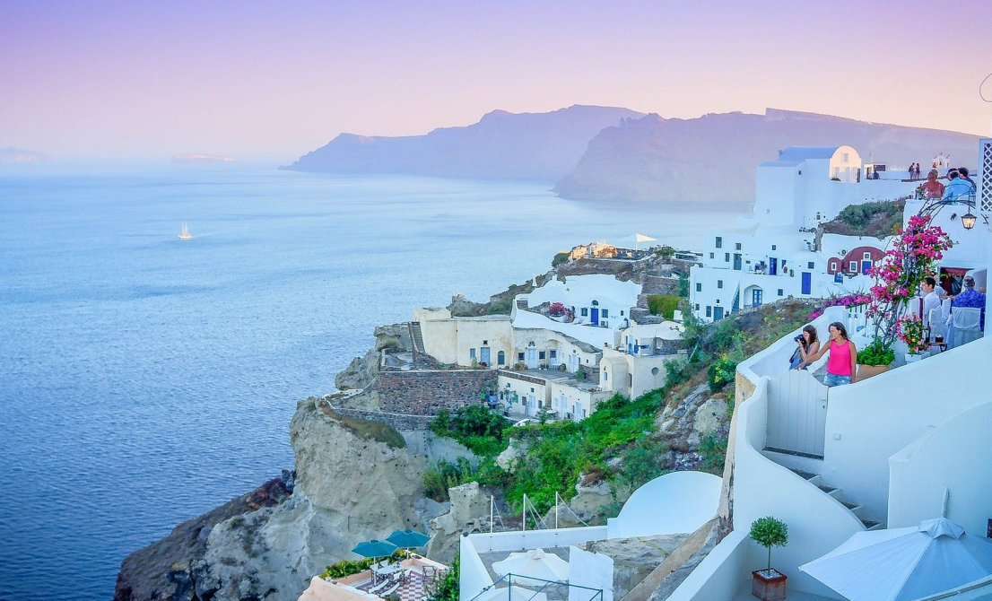 Santorini Greek island - sunset in Oia - Cruises in Greece - Greek cruises - Tours in Greece - Greek Travel Packages - Cruise Greek islands - Travel Agency in Greece