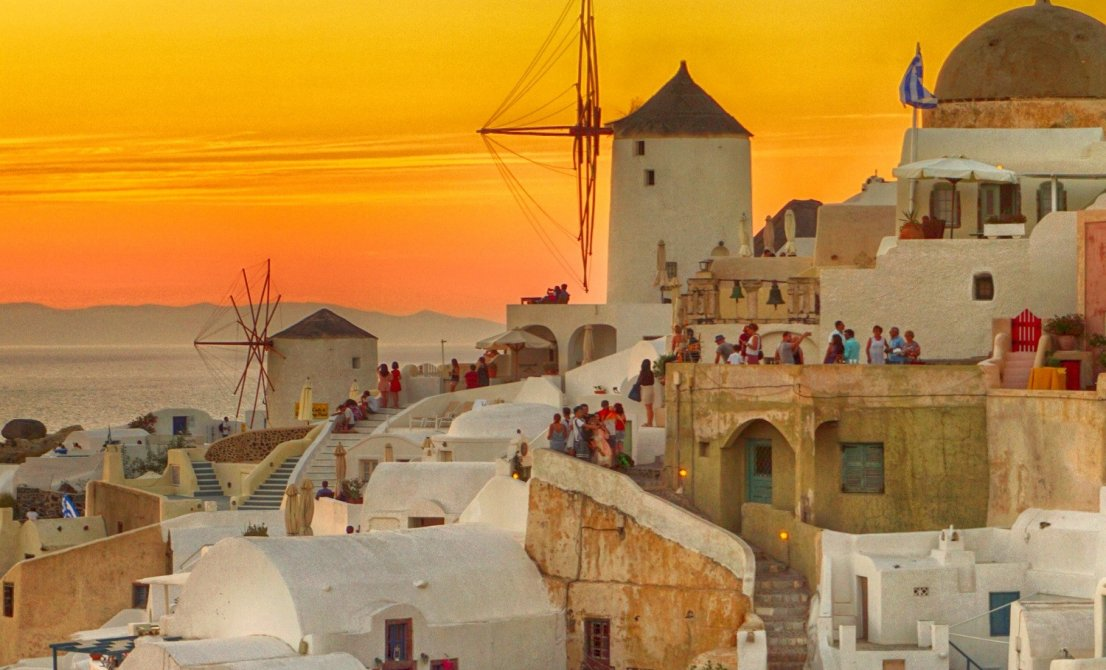 Santorini Greece - windmills under the sunset - Cruises in Greece - Greek cruises - Tours in Greece - Greek Travel Packages - Cruise Greek islands - Travel Agency in Greece